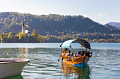Touristic boat on Lake Bled and the castle in the background. Bled, Upper Carniola, Slovenia