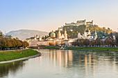 Historical old town of Salzburg reflected in Salzach river with Hohensalzburg Fortress in the background, Salzburg, Salzburger Land, Austria, Europe