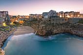 Lama Monachile also called Cala Porto at dusk, Polignano a Mare, Bari province, Apulia region, Italy