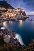 Dusk in Manarola, one of the Cinque Terre, Riomaggiore, Liguria, Italy