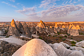 Tuff rock formations landscape at sunrise. Rose valley, Goreme, Capadocia, Kaisery district, Anatolia, Turkey.