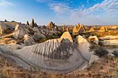 Tuff rock formations of Cappadocia. Rose valley, Goreme, Capadocia, Kaisery district, Anatolia, Turkey.