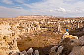 Tourist admiring the landscape of Love Valley. Goreme, Kayseri district, Capadocia, Turkey