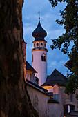 The medioeval Collegiata dei Santi Candido and Corbiniano church in the alpine village of San Candido during twilight. San Candido, Pusteria valley, Bolzano district, Dolomites, Trentino Alto Adige, Italy, Europe.