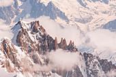 Arete du Diable, the rock high mountain ridge of Mount Blanc du Tacul. Chamonix, Alps, France, Europe.