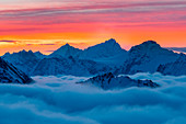 Weisshorn peak over a clouy carpet during a winter sunrise. Igloo refuge des Pantalons Blancs, Heremence, Sion, Valais canton, Switzerland, Europe.
