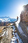 Hiker at Meyes, Valsavarenche, Gran Paradiso National Park, Aosta Valley, Italian alps, Italy