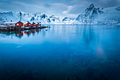Typical red houses reflected in the sea. Reine, Lofoten Islands, Northern Norway