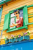 Relief of woman at window. El Caminito Street, La Boca district, Buenos Aires, Argentina.