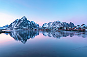 Mountain reflection at Reine Bay at sunset in winter. Reine, Nordland county, Northern Norway, Norway.