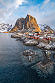 The fishing village with its traditional 'rorbus' in the winter morning light. Hamnoy, Nordland county, Northern Norway, Norway.