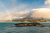 Rainbow over Lake Pehoé from an elevated point of view. Torres del Paine National Park, Ultima Esperanza province, Chile.