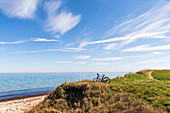 Bicycle on the steep coast of Siggen, Baltic Sea, Ostholstein, Schleswig-Holstein, Germany