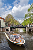 Boat on the Brouwersgracht canal in the Grachtengordel area in the Historical center of Amsterdam (North Holland, Netherlands)