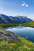 The Mont Blanc Massif reflected in the Checrouit Lake at sunset during the Mont Blanc hiking tours (Veny Valley, Courmayeur, Aosta province, Aosta Valley, Italy, Europe)\n