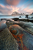 Rock like dragon eye at Uttakleiv beach at sunrise, Leknes, Lofoten, Nordland, Norway, Scandinavia, Northern Europe