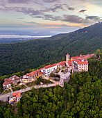 View of Santa Maria del Monte and the chapels of the sacred way during a spring sunset. Sacro Monte di Varese, Varese, Lombardy, Italy.