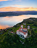 View of the fortress called Rocca di Angera during a spring sunset. Angera, Lake Maggiore, Varese district, Lombardy, Italy.