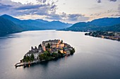 Aerial view of Orta San Giulio and Lake Orta at blu hour before a storm. Orta Lake, Province of Novara, Piedmont, Italy.