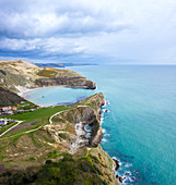 Aerial view of Lulworth Cove with Cathedral Cavern and Stair Hole, chalky formations near  West Lulworth, on the Isle of Purbeck in Dorset, Jurassic Coast, southern England.