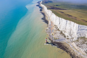 Aerial view of Beachy Head with it's Lighthouse, a chalk headland in East Sussex, England. It is situated close to Eastbourne, immediately east of the Seven Sisters. Southern England.