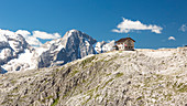 a view of the Franz Kostner alpine hut on the Sella Group with the Marmolada in the backgroun, Bolzano province, South Tyrol, Trentino Alto Adige, Italy,
