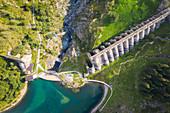 Aerial view of the ruins of the Diga del Gleno. Pianezza, Vilminore di Scalve, Scalve Valley, Lombardy, Bergamo province, Italy.