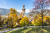 An autumnal view of the Bruneck, with the bell tower in the typical tyrolean style, Bolzano province, South Tyrol, Trentino Alto Adige, Italy