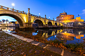 Blue hour in Rome in front of the Sant'Angelo bridge, the Tevere river and Castel Sant'Angelo. Rome, Rome district, Lazio, Europe, Italy.