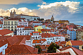 View of the roofs of Lisbon, the ancient monastery of São Vicente de Fora and the dome of the church of Santa Engrácia from Miradouro Alfama viewpoint. Lisbon, Portugal, Europe.