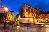 A tram pass on the streets of Alfama district in the evening in front of the Museum of Decorative Arts. Lisbon, Portugal, Europe.