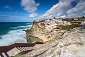 View of the town of Azenhas do Mar, located in front of the waters of the Atlantic Ocean. Sintra, Colares, Portugal, Europe.