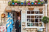 United Kingdom, Gloucestershire, Cotswold district, Cotswolds region, junk shop and souvenirs named Kate Rich and opened in 1981 with its owner on the doorstep