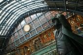 England, London, St Pancras, interior of St Pancras train station, statue of poet, Sir John Betjemen, proponent for saving the station, by sculptor Martin Jennings