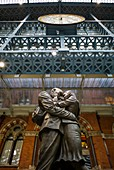 England, London, St Pancras, interior of St Pancras train station, sculpture, The Meeting Place, by Paul Day