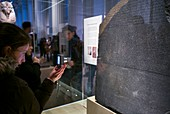 England, London, Bloomsbury, The British Museum, Egyptian Room, The Rosetta Stone, its discovery allowed the deciphering of the ancient Egyptian alphabet, being photographed by cell phone