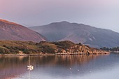 Scotland, Highland, Ross and Cromarty, Ullapool, evening light and stormy sky in front of the harbor
