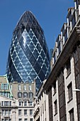 United Kingdom, London, business district of the City, Swiss Re Building and Swiss Re Building nicknamed the Gherkin (pickle) by the architect Norman Foster