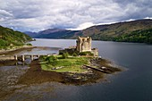 United Kingdom, Scotland, Highland, Dornie, Castle of Eilean Donan at the start of Loch Duich (aerial view)