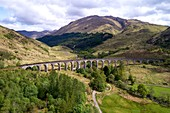 United Kingdom, Scotland, Lochaber district, Glenfinnan, West Highland Railway, Glenfinnan viaduct, made famous in JK Rowling's Harry Potter as the Hogwarts Express (aerial view)