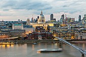 United Kingdom, London, Millenium Bridge of the architect Norman Foster with the City in the background with the Cathedral of St. Paul at nightfall