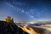 Starry sky with Milky Way over illuminated Rocca Calascio Castle, Rocca Calascio, Gran Sasso National Park, Parco nazionale Gran Sasso, Apennines, Abruzzo, Italy