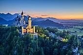 Neuschwanstein Castle, illuminated, in front of Tannheimer Bergen, Neuschwanstein, Ammer Mountains, Ammergau Alps, Swabia, Bavaria, Germany