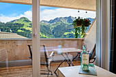 Panoramic window and balcony, Sunday, Großes Walsertal Biosphere Reserve, Bregenz Forest Mountains, Bregenzerwald, Vorarlberg, Austria
