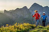 Man and woman hiking up to the Zafernhorn, Zitterklapfen in the background, Zafernhorn, Großes Walsertal Biosphere Reserve, Bregenzerwald Mountains, Bregenzerwald, Vorarlberg, Austria