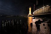 View of the lighthouse at the port of Lindau at night, Bavaria, Germany, Europe