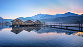 Boat huts at sunset at Kochelsee with jetty, Schlehdorf, Bavaria, Germany