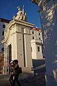 Visitors walk through the gate of Bratislava Castle, Bratislava, Slovakia.