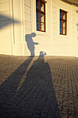 Shadow of two people in the evening light at the Bratislava Castle, Bratislava, Slovakia.