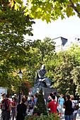 Tour group at the Hviezdoslav Monument in Hviezdoslav Square, Bratislava, Slovakia.
